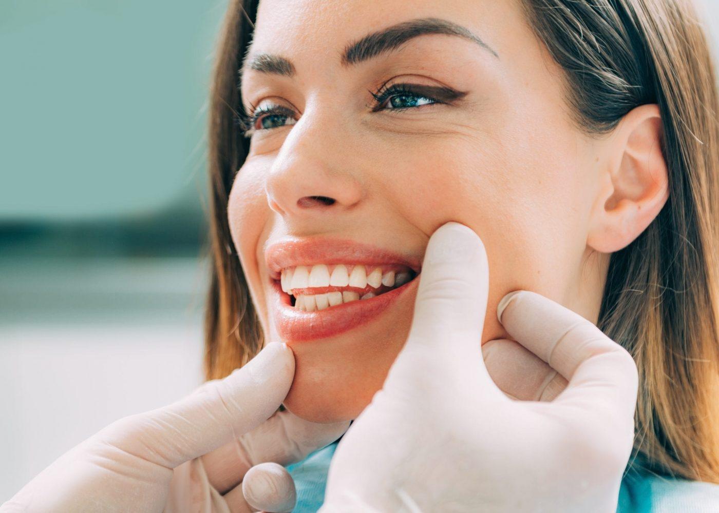 dentist-with-beautiful-female-patient-B5M9X2W.jpg